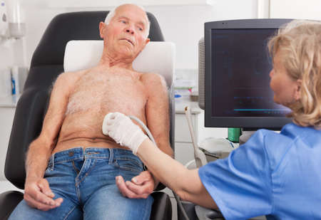 Doctor using ultrasound scan examining patient in hospital