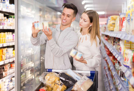 purchasers choosing yogurt and other dairy products