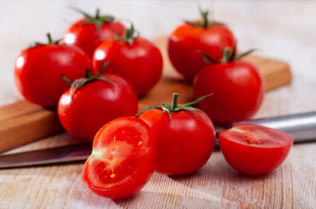 Whole and sliced tomatoes