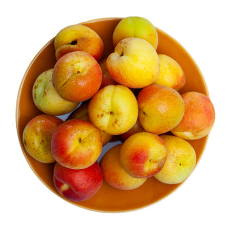 Whole and half fresh apricots