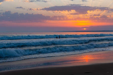 Summer sunny ocean waves and sunset in colorful tones