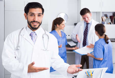 Male doctor welcoming to clinic