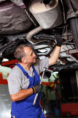 man mechanic engaged in car repair
