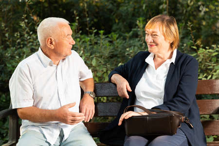 Senior man and woman on bench