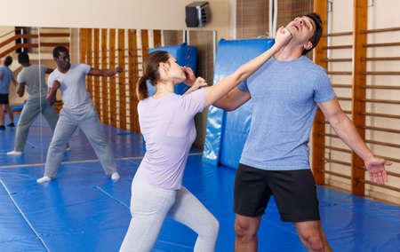 People practicing self defense techniques