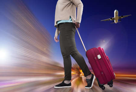 Woman with suitcase awaiting aircraft