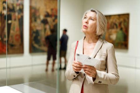 Mature woman visiting museum