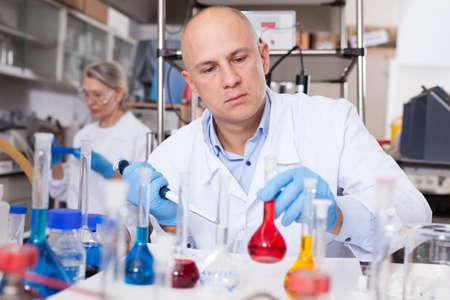 Chemist analyzing liquid samples Stock fotó