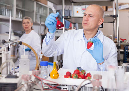 Geneticist working with fruits and vegetables