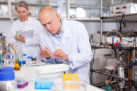 Lab technician working with reagents Foto de archivo