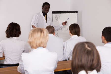 African American male giving presentation for medics