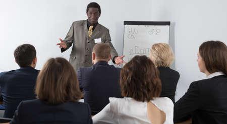 Male speaker giving talk in meeting room
