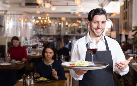 Bearded waiter with serving tray Stock Photo