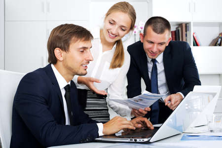 Business colleagues with document in hands Stock Photo