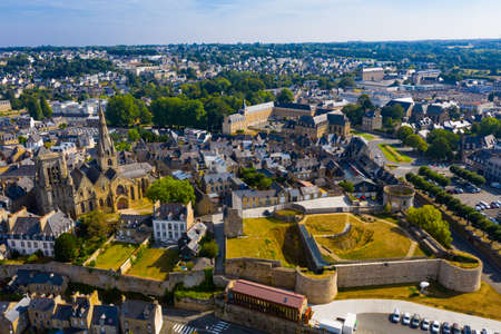 Flight over the city Guingamp and Basilica of Our Lady of Merciful on summer day