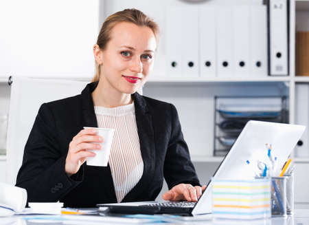 Woman in suit working in the modern office