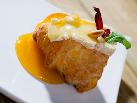 Croissant with camembert and honey