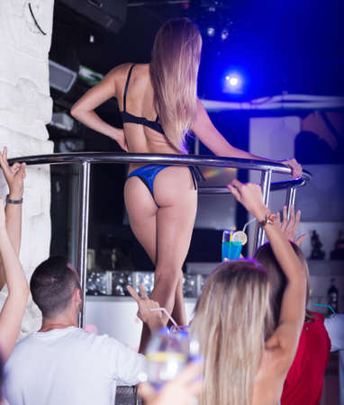 Ordinary woman dancer gogo dancing in the club