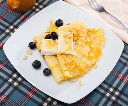 Crepes with brie and honey