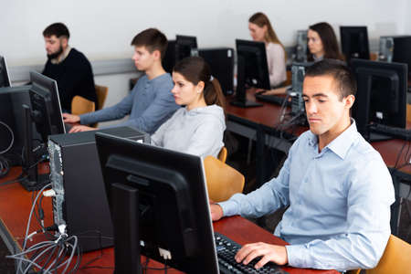 Students working on computers in classroom