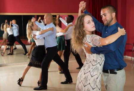 People dancing slow ballroom dances in pairs