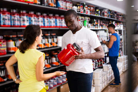 man recommending sports supplements to woman Stock Photo