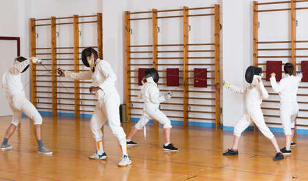 Ordinary group practicing fencing techniques