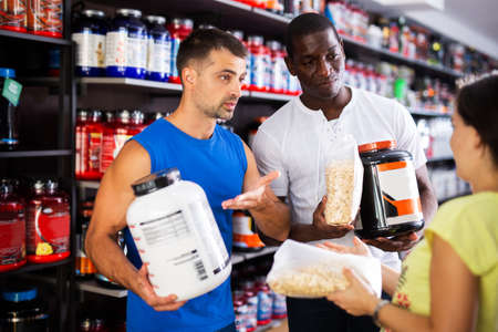 People discussing sports nutrition in shop