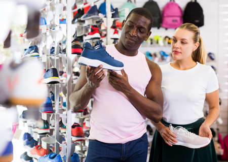 Adult couple choosing sports shoes