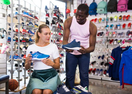 Female customer trying sports shoes