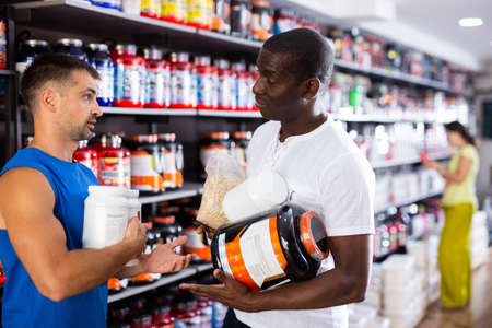 men with sports nutrition talking