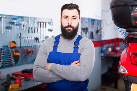 Beardy guy is showing his workplace Stock fotó