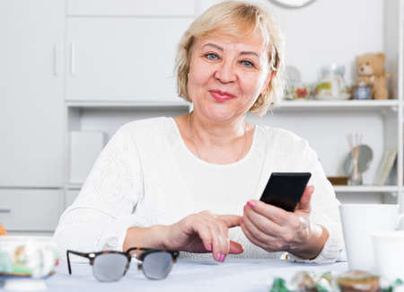 Mature woman with smartphone