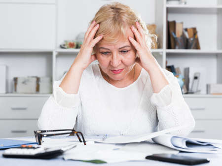 Woman engaged in home accounting