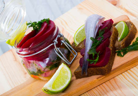 Pickled whiting in homemade marinade with beets