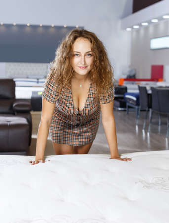 girl testing quality of new mattress Banque d'images