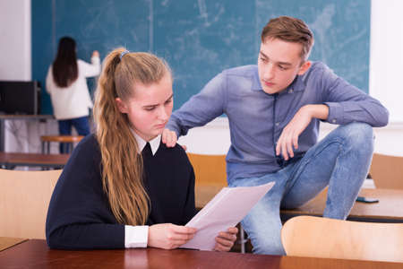 Teenager soothing girl classmate over failure of exam