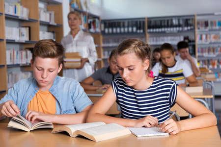 Teenagers in school library