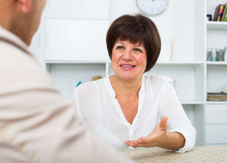 woman gets job and discusses with employer