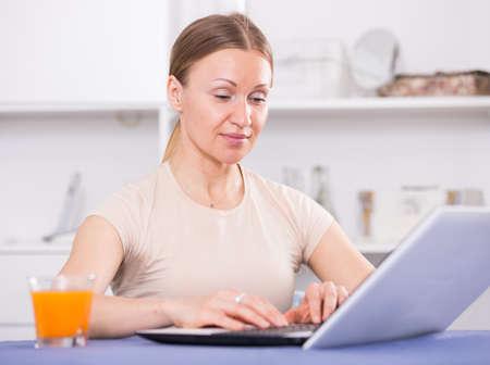 Woman working on laptop 写真素材