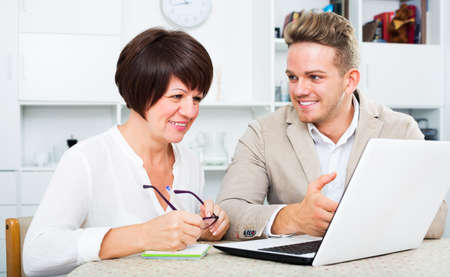 Man tells his mother about new software Фото со стока