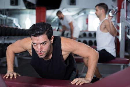 Man performing push-ups during training Stock Photo