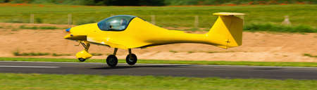 Sport airplane taking up from runway