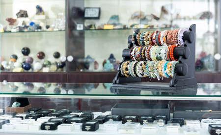 Semiprecious stone bracelets in glass case