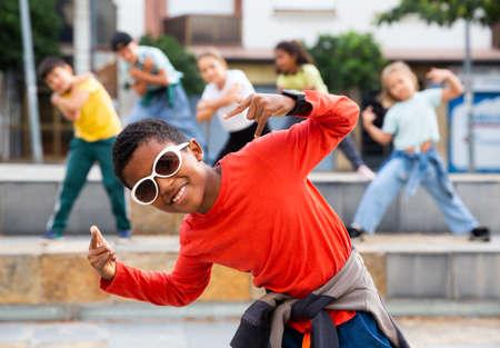 Boy hip hop dancer exercising outdoors 免版税图像