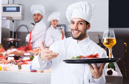 Chef standing in fish restaurant