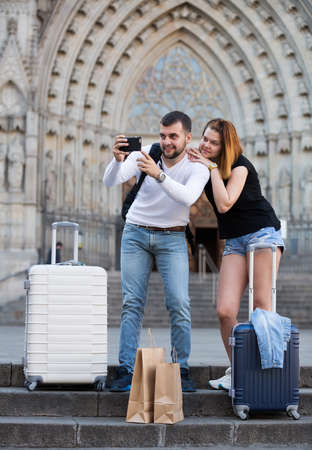man makes a selfie with girlfriend
