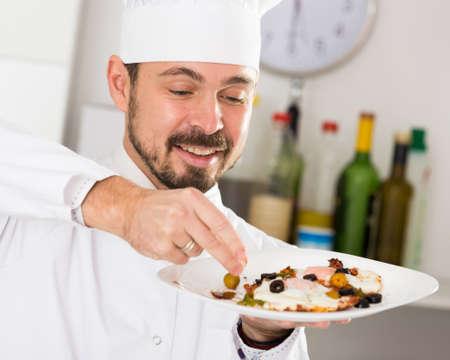 Male cook preparing food