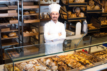 Favorable baker showing assortment of bakery
