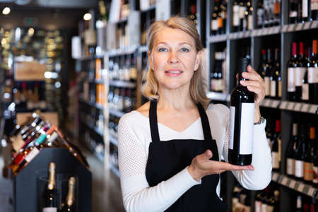 Female vintner recommending wine